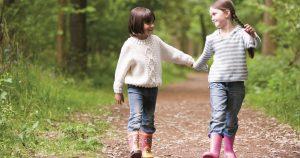 Girls holding hands at Caulbridge School